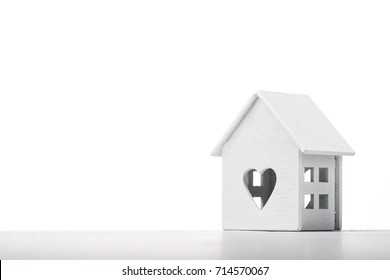 white house model icon with heart symbol isolated on white background. concept of family happiness and love
