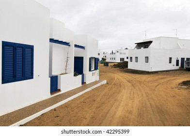White house with red earth (Isla Graciosa, Canary Islands)