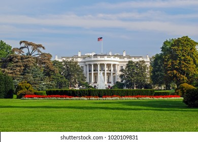 The White House south facade with green lawn and flowerbed. Washington DC, USA