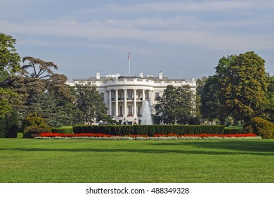 The White House south facade with green lawn and flowerbed. Washington DC, USA  Perfect background for a text