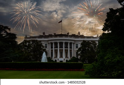 The White House, Washington DC of beautiful colorful holiday fireworks in the evening sky with majestic clouds