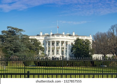 The White House in Washington DC with beautiful blue sky, White House flags at half mast for late President George HW Bush , 26 dec 2018