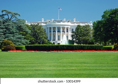 The White House in Washington DC with beautiful blue sky in background