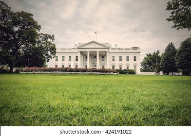 The White House in Washington D.C. at a cloudy day, green lawn in foreground, Executive Office of the President of the United States, USA, vintage filtered style
