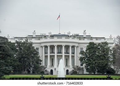 The White House in Washington DC on a cloudy day.