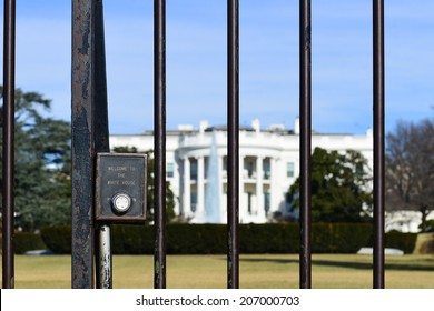 """The White House with """"Welcome to White House"""" embossed fence in focus - Washington D.C. United States"""