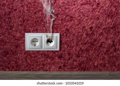 white household socket has burned from short circuit