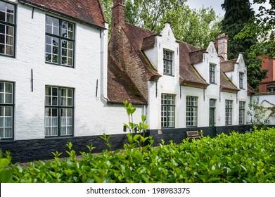 White houses in the Beguinage (Begijnhof) in Bruges, Belgium