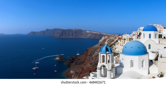 White houses and blue domes of Oia, Santorini - Panoramic view