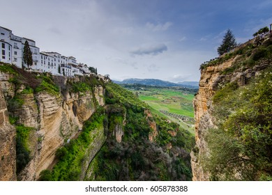 White houses hanging from cliffs in Ronda,Spain. View include famous  Puente Nuewo New Bridge