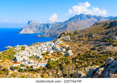 White houses of Mesochori village in mountain area on sea coast of Karpathos island, Greece