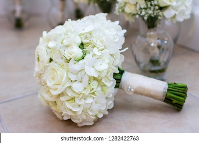 White Hydrangea Bridal Bouquet on Table