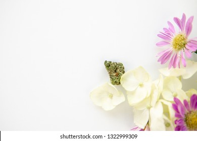 White Hydrangea and Purple Daisy Cannabis Floral Bouquet with Bud for Marijuana Product Background Frame - Top Down Right Close up