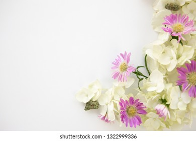 White Hydrangea and Purple Daisy Cannabis Floral Bouquet for Marijuana Product Background Frame - Top Down Right