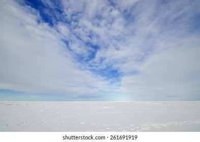 White ice and blue sky