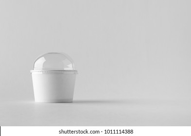 White ice cream paper cup mock-up with plastic lid.