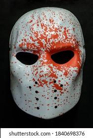 White Ice Rink Raider Mask With Blood Splattered Isolated Against Black Background
