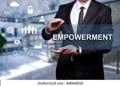 "White icon with text ""Empowerment"" in the hands of a businessman. Business concept. Internet concept."