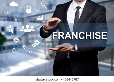 "White icon with text ""Franchise"" in the hands of a businessman. Business concept. Internet concept."