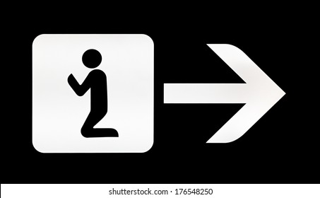 White illuminated sign with direction for prayer room on airport