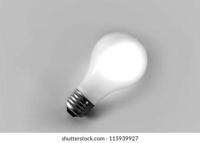 White Incandescent Light Bulb Isolated on White Backdrop