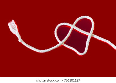 white innocent love heart on a bright red background