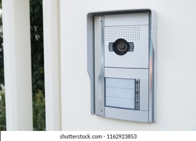 white intercom with a camera on the door of a private house