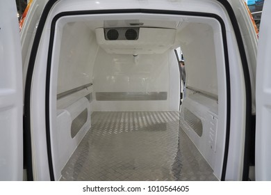 White interior of the cargo area of the new fridge van. Refrigeration unit inside.
