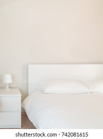 White interior. Simple decoration. Detail of a bedroom