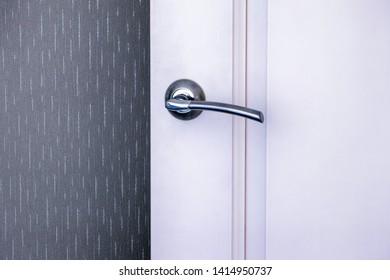 White interroom door with handle. Close-up.