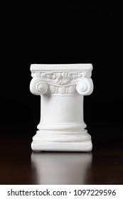 White Ionic Design Column on Dark Background.
