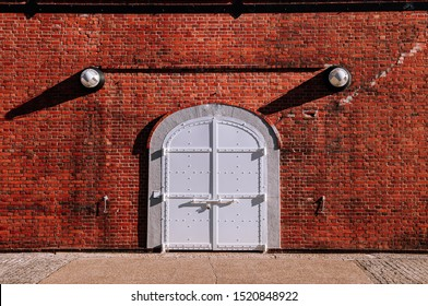 White iron gate with red brick wall old rustic industrial loft retro vintage warehouse wall