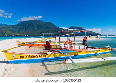 White Island Camiguin Philippines April 23, 2018 Traditional outrigger boats on the sand bar known as White Island