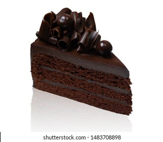White isolated background with clipping paths close up triangle slice piece of dark chocolate fudge cake decorated with chocolate curl. Di cut with path simply use to create your any design.