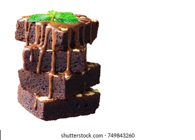 White isolated background with clipping paths homemade dark chocolate brownies topping with almond slices and mint delicious bitter sweet and fudge. Brownie is one type of chocolate cake.
