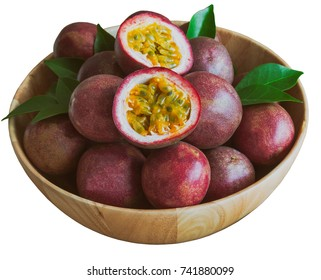 White isolated background of ripe fresh passion fruit in wood bowl in side view with copy space. Tropical fruits so delicious with sweet and sour taste.