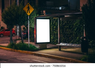 White isolated backlit ad space at a bus stop on the street
