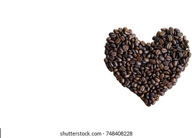 White isolated with clipping paths for design of beautiful heart shape from roasted robusta or arabica coffee beans in top view flat lay with copy space for background or wallpaper. Love theme concept