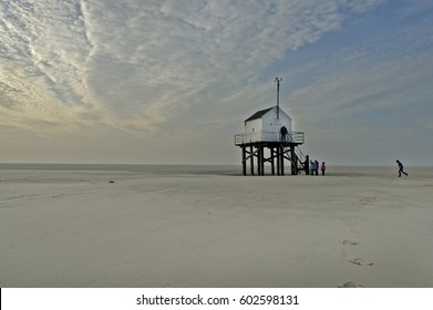White isolated safe house on a deserted beach on the island Vlieland, The Netherlands