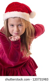 White isolation of a cute girl wearing santa hat blowing a kiss to viewer