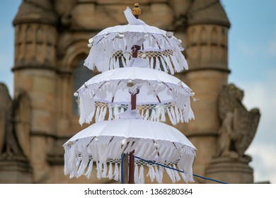 White Japanese umbrella or parasol with building in background