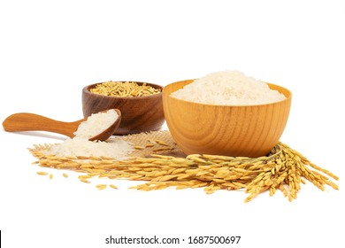 White Jasmine rice in a wooden bowl and wooden spoon and paddy rice and with Ear of rice isolated on white background