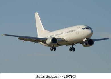 White jet airplane is landing