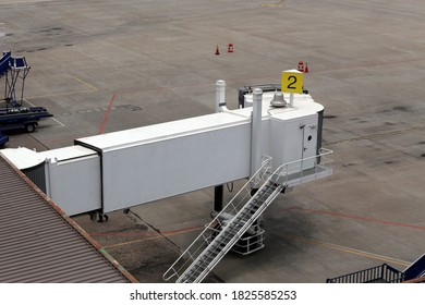 White jetway in the airport terminal