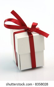 white jewel gift box with red ribbon on white background