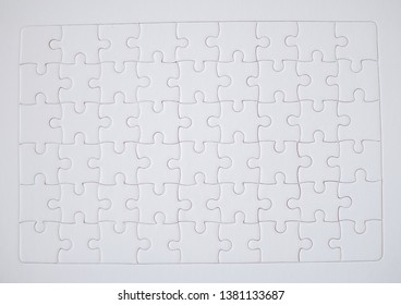 White jigsaw puzzle business strategy