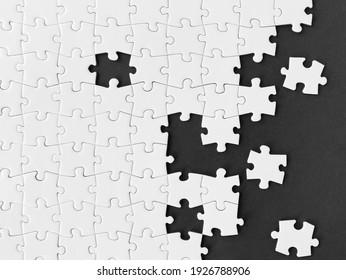 White jigsaw puzzle on black background