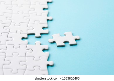 White jigsaw puzzle on blue background