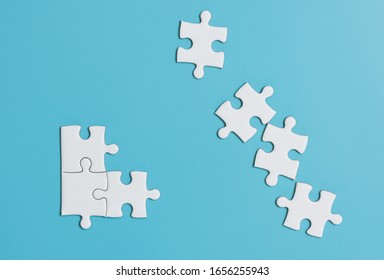 White jigsaw puzzle on blue background.