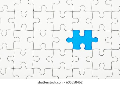 White jigsaw puzzle on blue background.